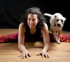 Beth Sanchez in a yoga pose with her favorite dog friend