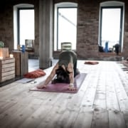 woman in dog pose in a yoga studio