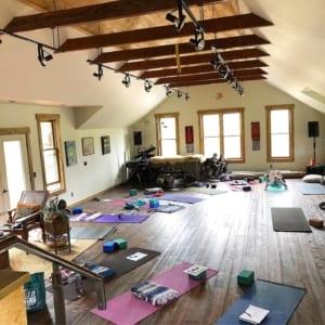 empty yoga teacher training studio space.