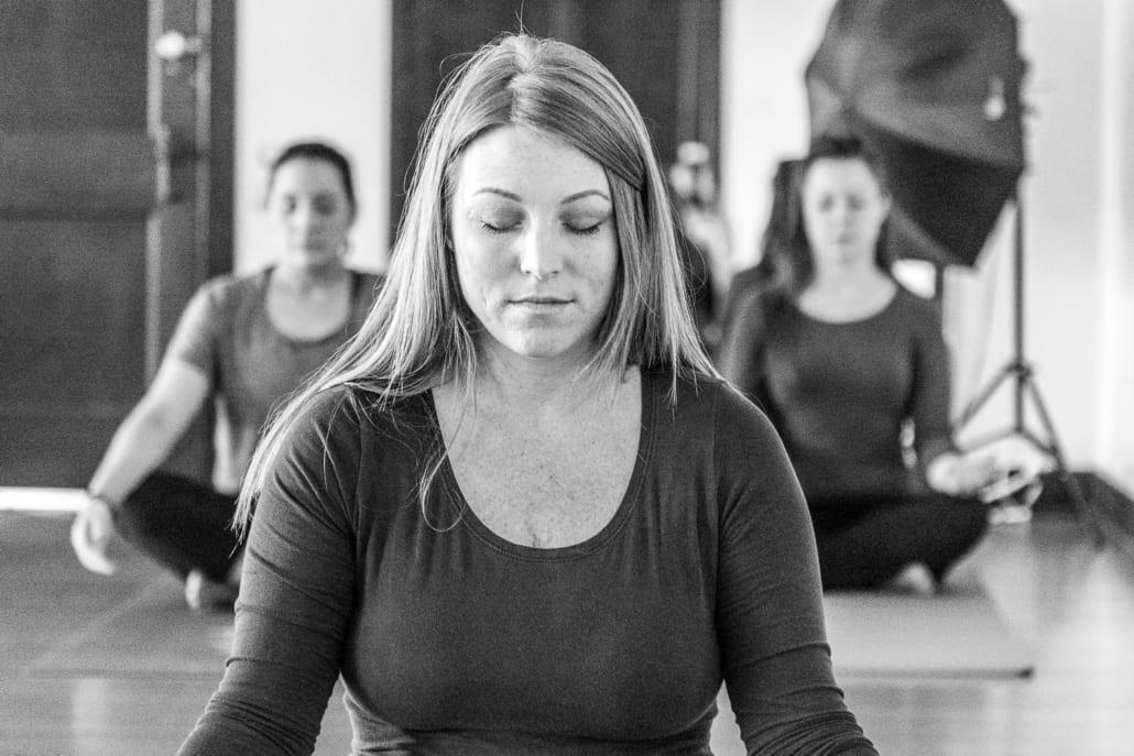 Yoga training student in meditation