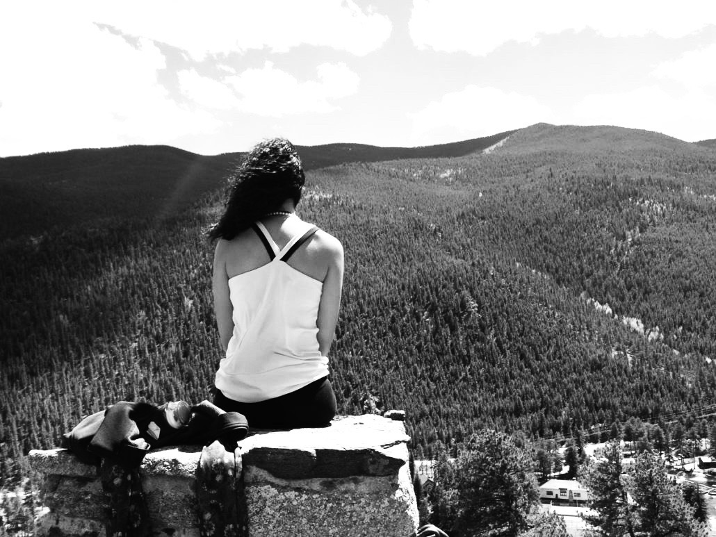 Woman takes in the view while on a yoga retreat.