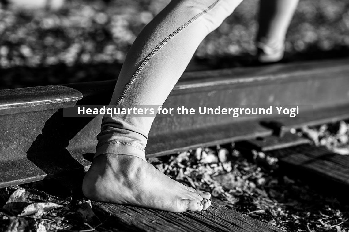 Yoga posture on the railroad tracks.