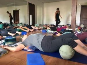 Yoga teacher walks in the classroom