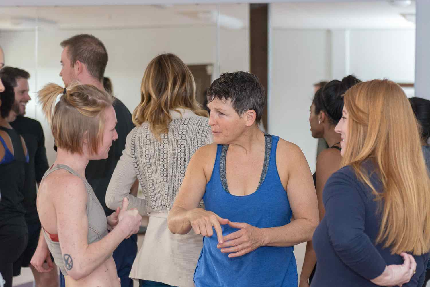 three female school teachers and social workers discuss the benefits of yoga.